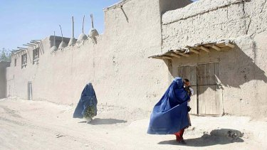 Cleaning up the streets: Women in Logar province.