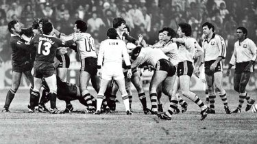 Actions speak louder than words ... players sort out a difference of opinion during an Origin match at the SCG in 1983.
