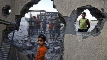 Palestinian children near the site of an Israeli missile strike in Rafah, southern Gaza Strip.