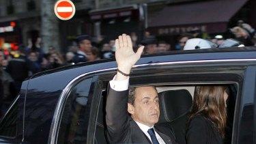 Waving goodbye ... outgoing French President Nicolas Sarkozy.