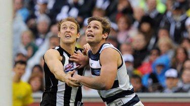 The battle between Magpie Ben Reid and Geelong's Tom Hawkins will be a key one tonight.