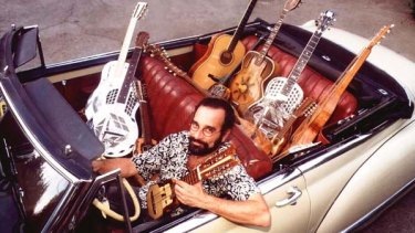 Bob Brozman with his quiver of stringed instruments.