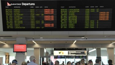 Qantas passengers try to make alternative travel arrangements after the grounding of all aircraft.