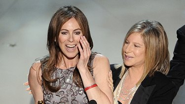 Kathryn Bigelow (left) collects an Oscar for  The Hurt Locker.