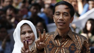 """Indonesian presidential candidate Joko """"Jokowi"""" Widodo and his wife Iriana after casting their vote in Jakarta on Wednesday."""