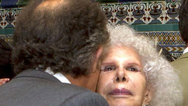 You may kiss the bride ... Alfonso Diez pecks the Duchess of Alba on the cheek.