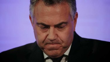 Treasurer Joe Hockey delivers the Mid-Year Economic and Fiscal Outlook at the National Press Club of Australia in Canberra on Tuesday.