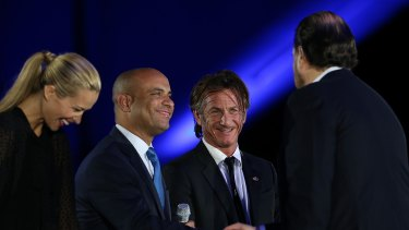 (L-R) Happy Hearts Fund founder Petra Nemcova, Haiti prime minister Laurent Lamothe and actor Sean Penn greet Salesforce chairman and CEO Marc Benioff at the 2013 Dreamforce conference.