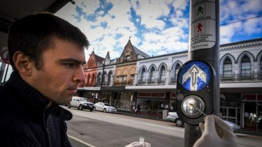 Monash University science undergraduate student Andrew Gray collects samples of bacteria in Brunswick.