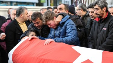 Relatives and friends mourn Ayhan Arik, one of the 39 victims of the nightclub attack.