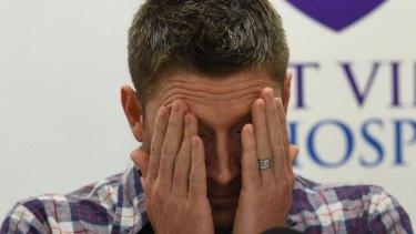 Overwhelmed: Australian cricket captain Michael Clarke over Phillip Hughes' death in November.