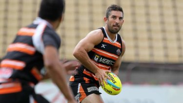 Veteran five-eighth Braith Anasta controls proceedings during Wests Tigers training at Concord Oval.