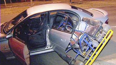 Tight fit ... three men attempting to steal a go-kart came unstuck when they tried to fit it into the back of this Holden Commodore .