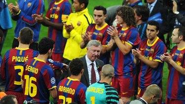 Sir Alex Ferguson congratulates Barcelona players on their win.