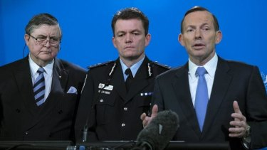 Prime Minister Tony Abbott on Friday, with ASIO Director General David Irvine and AFP Commissioner Andrew Colvin.