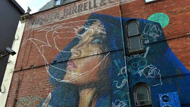 Street art, such as this mural in Johnston Street, Fitzroy, is increasingly being defaced by disillusioned taggers.