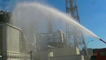 A fire engine douses reactor No. 3.