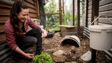 Kat Lavers in the aviary in her Northcote backyard where she keeps her quails.
