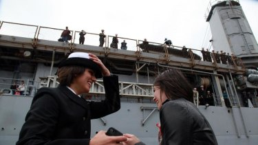 "Marissa Gaeta returns from 80 days at sea and greets her girlfriend Citlalic Snell, to give her the coveted ""first kiss"" on the pier, following  the repeal of the US military's ""don't ask, don't tell"" rule."