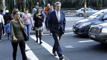 Now just a man on the street: Barry O'Farrell walks across Macquarie Street.