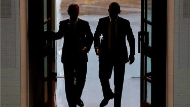 Guess who?: Leaders of the House Christopher Pyne and Prime Minister Tony Abbott enter Parliament for question time on Thursday.