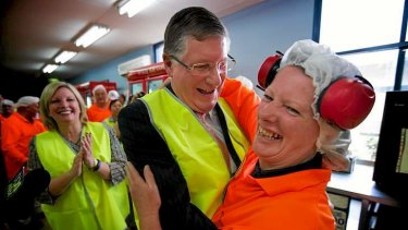 Just peachy: Premier Denis Napthine gives plastics operator Robyn Tuffnal a hug.