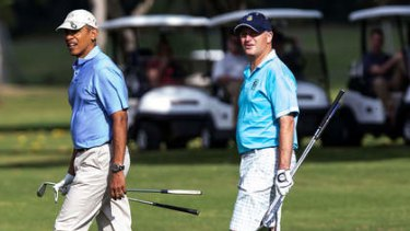 Linked in: Key playing golf with Barack Obama in Hawaii in January.