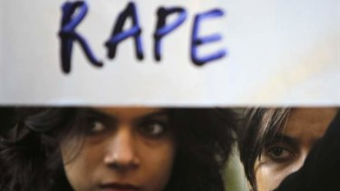 A protester holds a placard during a rally demanding the state government to ensure the safety of women in the capital city.