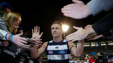 Cats midfielder Joel Selwood high fives supporters after Geelong's victory in his 100th game.