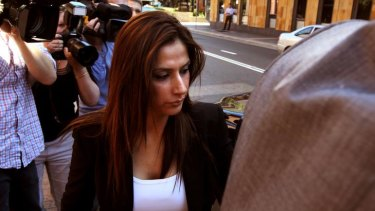 Mick Hawi's wife, Carolina Gonzales, leaves Parramatta court after the verdict.