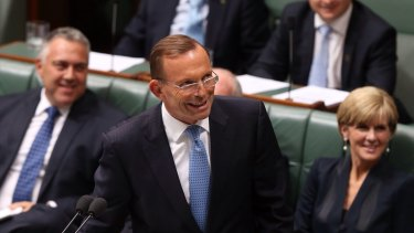 "Prime Minister Tony Abbott smiles at the press gallery after he withdraws his description of   Opposition leader Bill Shorten as ""the Dr Goebbels of economic policy"" during question time  on Thursday."