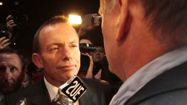 """Here's looking at you: Tony Abbott is confronted by """"journalist"""" Mark Latham at the Penrith RSL Club yesterday. <i>Picture: Glen McCurtayne</i>"""