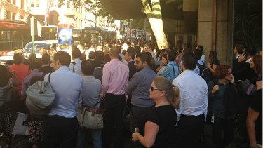 Commuters wait for buses on Druitt Street.