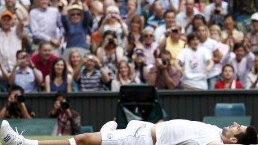 Serbia's Novak Djokovic celebrates after defeating Rafael Nadal of Spain in the men's singles final at Wimbledon.