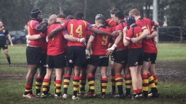 Chris Noble's football team The Dirty Reds wore black armbands at their match yesterday.