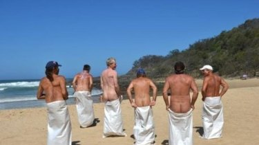 Competitors enjoy the sack race during Nudist Day at Alexandra Beach.