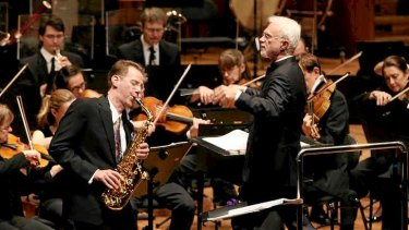 Sydney Symphony Orchestra accompany Saxophonist Tim McAllister with conducting by John Adams at the Sydney Opera House.