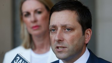 Opposition Leader Matthew Guy with opposition front bencher Georgie Crozier in the background.