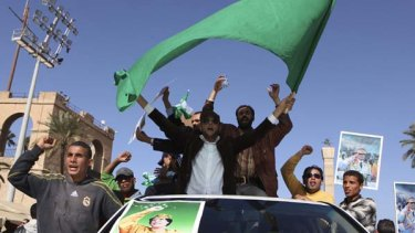 Muammar Gaddafi supporters take to the streets in Tripoli.