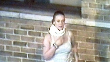 Wanted ... A young woman removes her face mask in Croydon as the cameras roll.