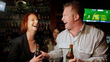 Where everybody knows your name ... the Prime Minister, Julia Gillard, has a beer at The Australian pub in New York with publican Matt Astill on her last night on tour.