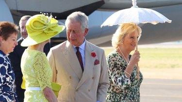 Sunny start … the Prince Charles and Camilla, the Duchess of Cornwall, arrive in Longreach.
