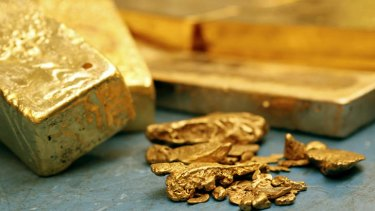 Blocks of unrefined gold bars and gold nuggets wait to be processed at a refinery in Italy.