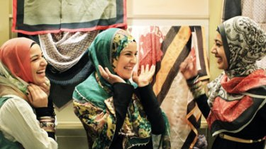 Looking good... Mouna Fattouh, her sister Ruby and Manaal Fatima, from left, try on the latest prints at Hajib House in Centro Mall, Bankstown.
