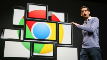 Google chief executive Sundar Pichai, pictured with images of mobile devices bearing the Chrome logo.