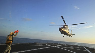A Dolphin Z-9 helicopter of China's Navy missile frigate CNS Yulin flies off the deck of Singapore's Navy missile frigate RSS Intrepid in the South China Sea on May 25.