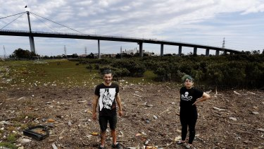 On duty: Nicko Lunardi and Laura Kelly of Scab Duty picking up rubbish at Stony Creek Backwash, Yarraville