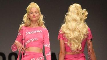Models walk for Moschino at Milan Fashion Week, 2014.