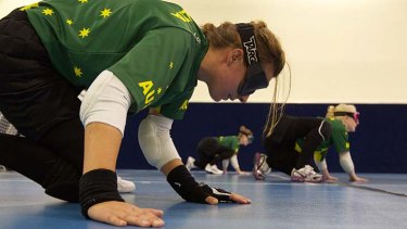In medal mode ... Australian goalball squad members, from left, Michelle Rzepecki, Tyan Taylor and Jenny Blow train at Trinity Grammar for the Paralympics which start in London on August 29.