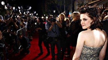 Bizarre and intrusive ... Kristen Stewart intimidated by over-zealous paparazzi.